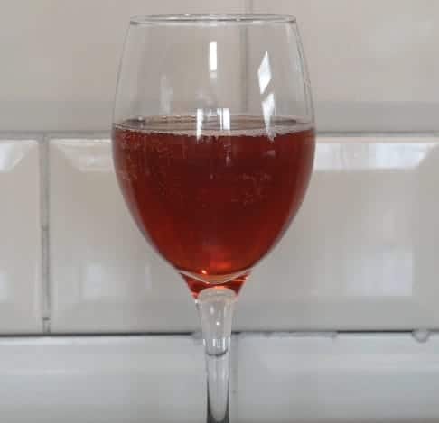 Glass of beetroot wine.