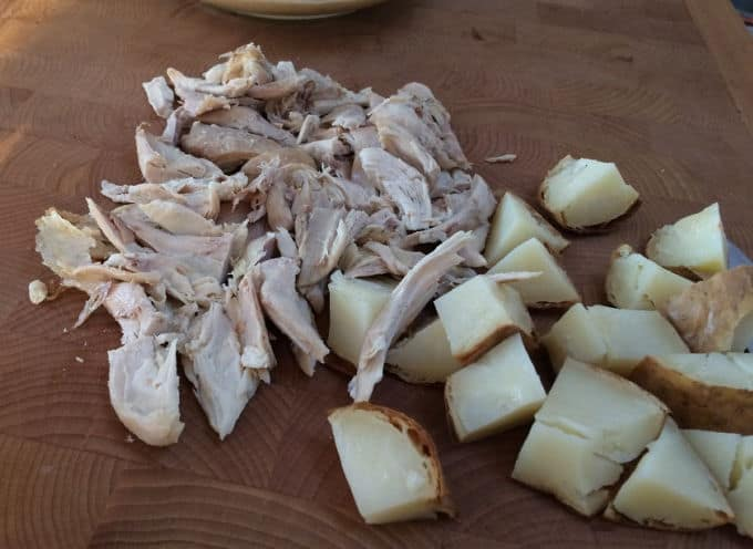 Chopping cooked chicken and potatoes