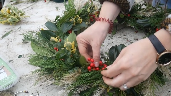 Filling gaps in the foliage on a Christmas wreath.