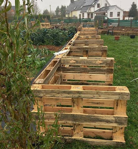 pallets safe to use in the garden made into a fence